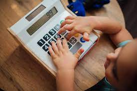 Young girl playing with the calculator. | Nenad Stojkovic | Flickr